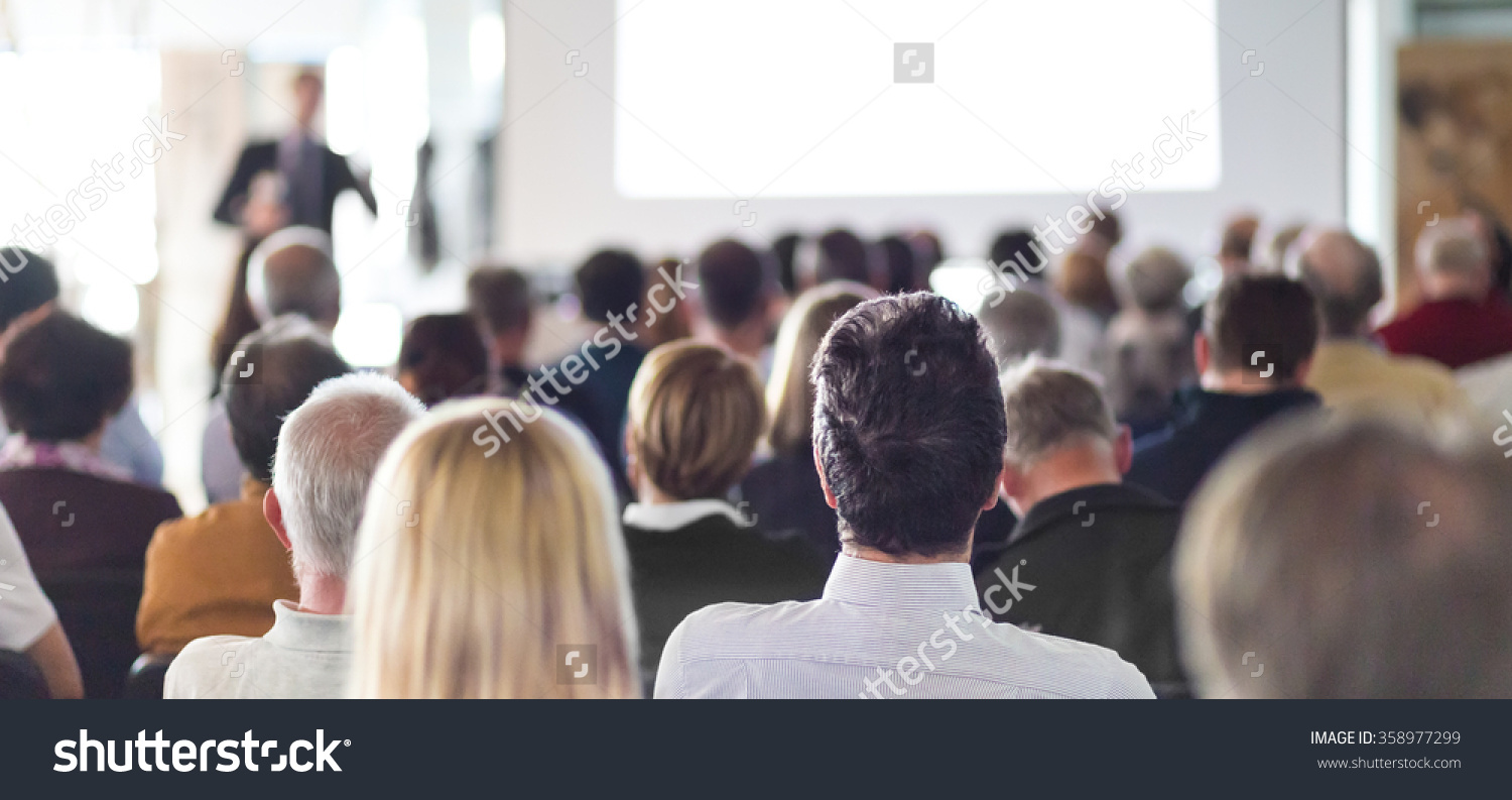stock-photo-speaker-giving-a-talk-at-business-meeting-audience-in-the-conference-hall-business-and-358977299